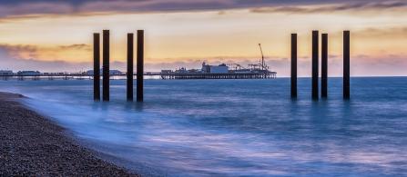 Brighton Piers at Dawn by Robert Williams