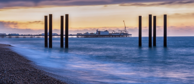 Brighton Piers at Dawn by Robert Williams