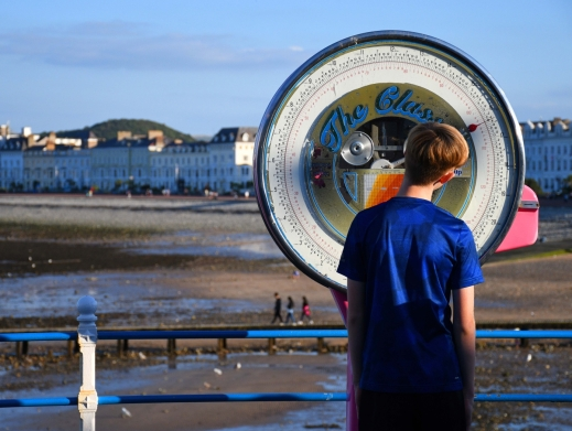 Weighing in on Llandudno pier by Gill Hitchcock